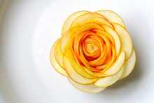Rose Carved From Apple, On Whi...