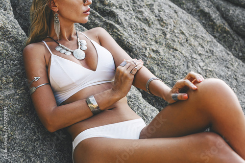 Photo  Model in white bikini and wearing boho jewellery