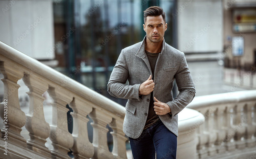 Fototapeta Handsome man in fashinable outfit walking