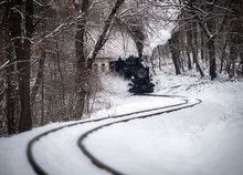 Budapest, Hungary - Beautiful Winter Forest Scene With Snow And Old Steam Locomotive On The Track In The Hungarian Woods Of Huvosvolgy