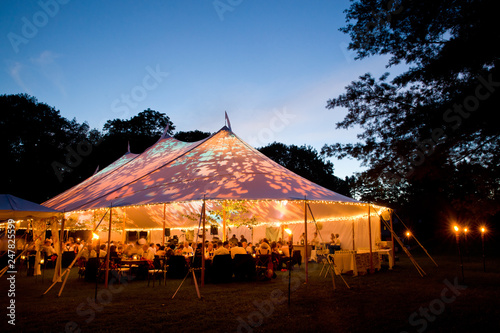 Wedding tent at night - Special event tent lit up from the inside with dark blue Tableau sur Toile