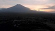 High Drone shot tracking right of mount agung at Sunset, volcano in Bali, Indonesia, 4k drone footage, asia