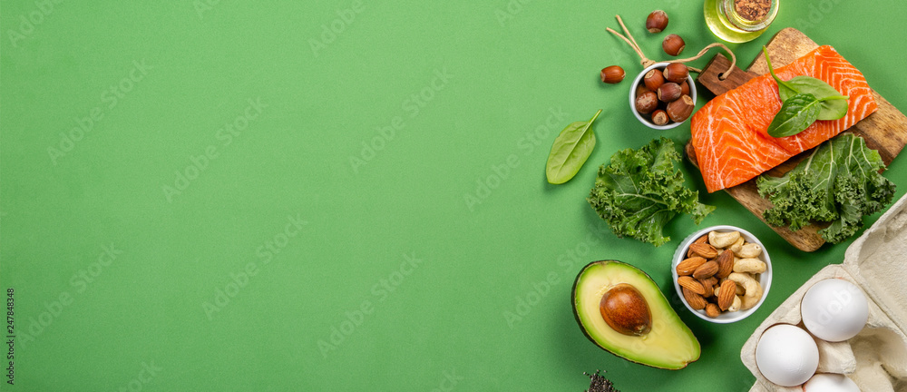 Fototapety, obrazy: Keto diet concept - salmon, avocado, eggs, nuts and seeds, bright green background, top view