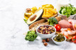 Mediterranean diet concept - meat, fish, fruits and vegetables on bright green background