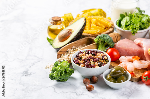 Fotografía  Mediterranean diet concept - meat, fish, fruits and vegetables on bright green b