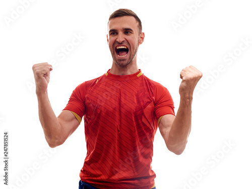 Fotografie, Obraz  Athlete / fan on red uniform celebrating on white background