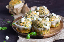 Savory Muffins With Spinach And Feta Cheese On Old Brown Concrete Background.