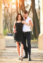 Passionate Elegant Young Couple Latino Dancers In Tango In The Park