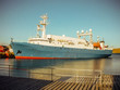 Industrial ship in port deck. Sea vessel in harbor