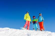Happy Family Enjoying Winter V...
