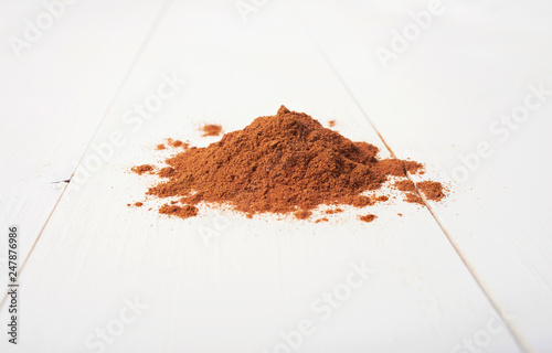 Fotografie, Obraz  cinnamon powder isolated on a wooden table