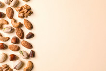 Flat Lay Composition With Organic Mixed Nuts And Space For Text On Color Background