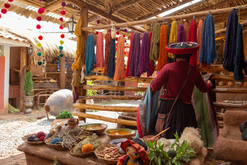 Chinchero, Cusco, Peru. December 2018, Process of natural dyeing of alpaca and llama wool, Quechua woman.