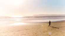 Ocean Beach At Sunset And Boy Running Along Shore Of Pacific Ocean Seaside At San Diego City In California Usa Retro Vintage Style Photo Vacation Happy Childhood Panoramic Scene