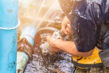 Plumber Working Repair The Bro...