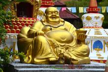 Large Golden Statue Of Seated Laughing Buddha In Wat Koh Wanararm, Langkawi Island, Malaysia