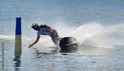 Papiers peints Nautique motorise Motosurf Competitor taking corner at speed making a lot of spray.