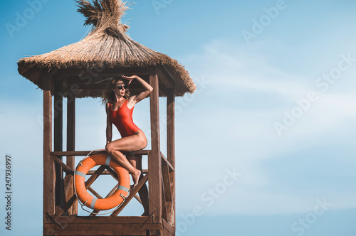 young lifeguard woman on the tower. baywatch. Wallpaper Mural