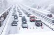 canvas print picture - Langer Stau auf verschneiter Autobahn