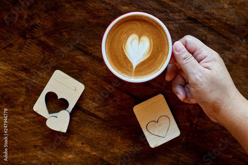 Foto op Plexiglas Cup of coffee latte in coffee shop