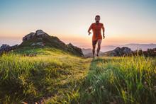 Man Trail Running On A Mountai...