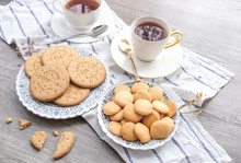 Digestive Cookies Biscuit On White Vintage Plate Ceramic Modern Cup Of Tea  On White Tea Towel On Wooden Panel Floor. Selective Focus Food Styling