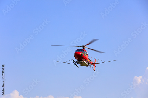 Staande foto Helicopter Agricultural helicopters flying in the air, Luannan County, Hebei Province, China