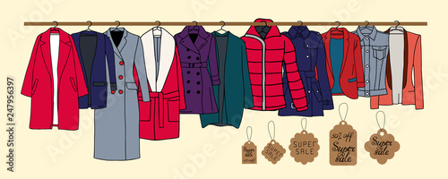 Obraz Vector illustration of warm outerwear that hangs on hangers. Also presented tags and an indication of sales. - fototapety do salonu