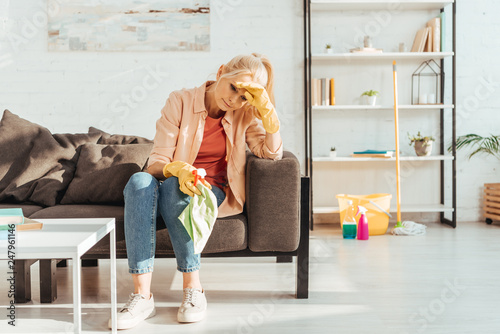 Fotografia  Tired senior woman with rag resting on sofa