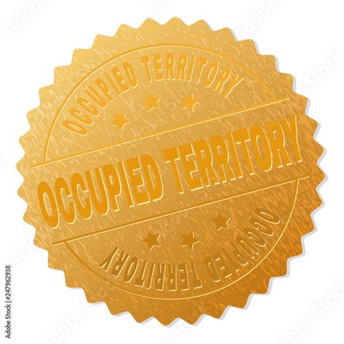Valokuva  OCCUPIED TERRITORY gold stamp medallion