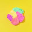 Leinwanddruck Bild - Colorful slime on bright yellow background. Minimal creative art concept.