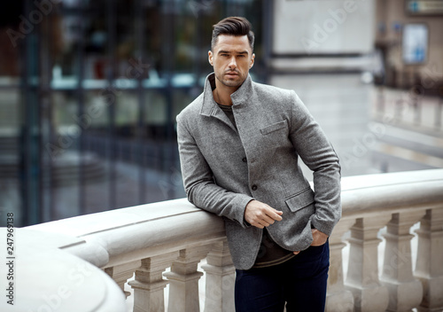 Fotografía  Handsome male model wear gray classic jacket