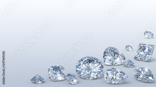 Photo Variously cut diamonds scattered along the image corner on light blue background