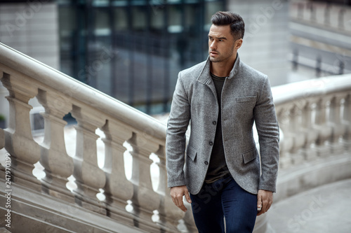 Handsome man in fashinable outfit walking