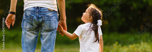 Fotografie, Obraz  Dad is holding daughter's hand at day time