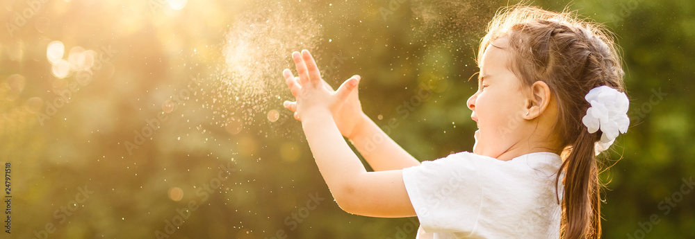 Fototapety, obrazy: Adorable little girl, has happy fun with cheerful smiling face. Carefree child Running and jumping on green summer meadow, catching soap bubbles. Happiness, childhood and freedom concept.