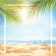 Summer background with frame, nature of tropical golden beach with rays of sun light and leaf palm. Golden sand beach close-up, sea water, blue sky. Copy space, summer vacation concept.