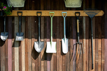 Gardening Tools Hang On Wooden Wall, Tool Concept