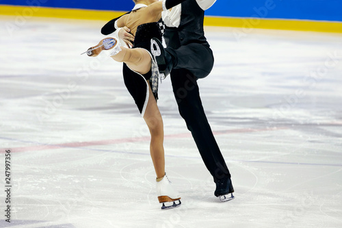 Fototapeta figure skating pair skaters in free skating compete