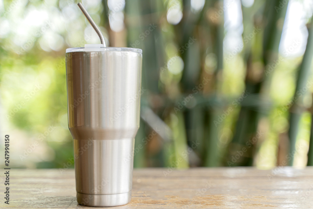 Fototapeta Stainless steel tumbler with stainless straw keeping of the drink cold or hot.