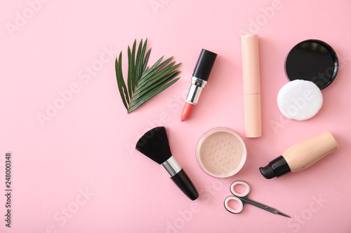 Set of cosmetics with accessories on color background
