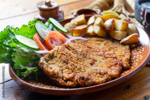 Photo  Traditional milanese beef and french fries