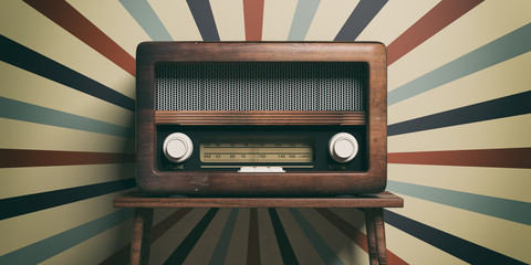 Radio old fashioned on wooden table, retro wall background, 3d illustration