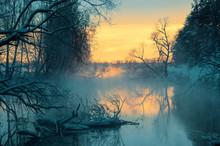 Scenic Sunrise Over The Winter River.