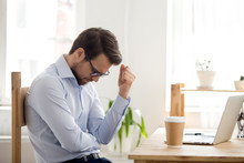 Frustrated Man Feeling Loser Sitting Near Laptop Shocked By Bankruptcy