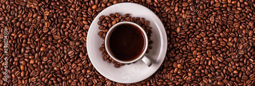 Wall Murals Cafe Cup of coffee on a background of coffee beans