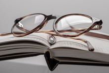 Diary Planner Opened Book, Reading Glasses And Pen Close-up