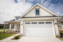 Modern New Construction White Siding Cottage House For Sale In Suburbs With Turquoise Door