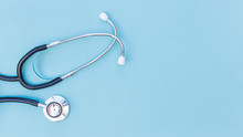 An Elevated View Of Stethoscope Over Blue Background