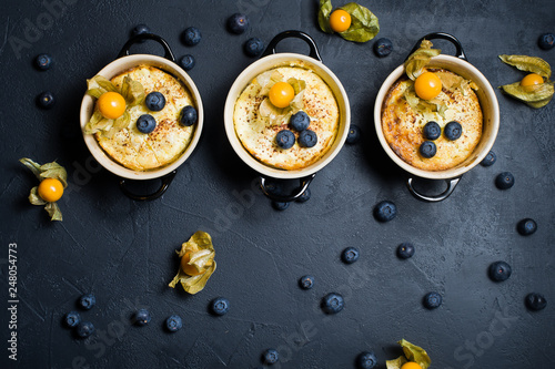 Three portions of classic English rice pudding  Blueberries and